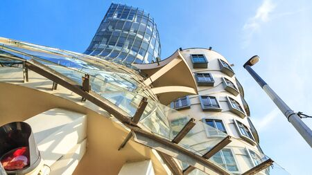 Urban landscape - view of the Nationale-Nederlanden Building in the style of deconstructivism nicknamed the Dancing House or Fred and Ginger, in the Prague, the Czech Republic Stok Fotoğraf