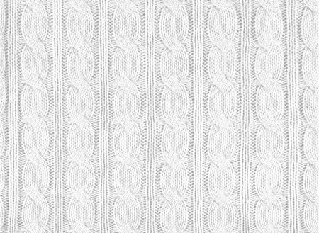 White knitted textured background with a pattern, acrylic and cotton knit fabric, closeup