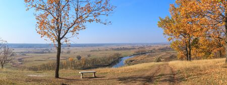 Autumn landscape, banner - view from the hill above the river valley on a sunny day, the northeast of Ukraine