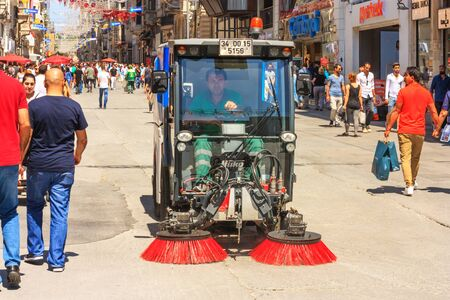 Summer city landscape - view of the janitor operating the cleaning machine on the streets of Istanbul, in Turkey, 3 June, 2017