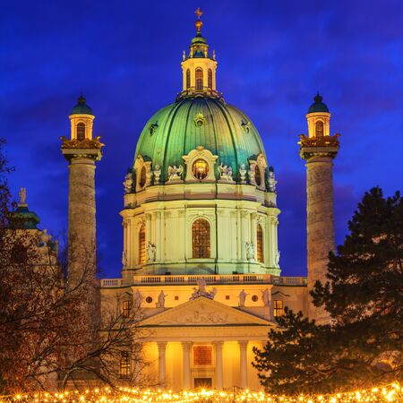 Festive cityscape - view of the Karlskirche (St. Charles Church) and the Christmas Market on Karlsplatz (Charles Square) in the city of Vienna, Austria Stock fotó