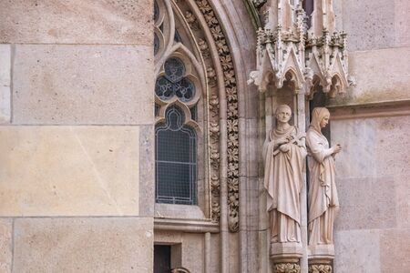 City landscape - view of the sculptures of the neo-Gothic church Votivkirche (Votive Church) in the city of Vienna, Austria