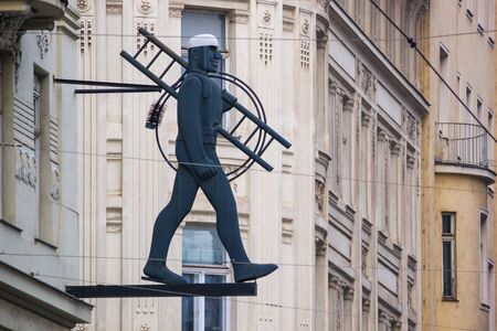 City landscape - close-up view of a chimney sweep sculpture on a street of the Old Town of Vienna, Austria Stock fotó