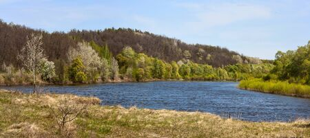 Springtime landscape, banner, panorama - view of the river bank in the spring in the north of Ukraine