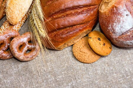 Fresh bread and bakery in the form of background, close-up and with selective focus