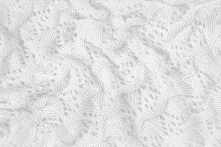 Abstract vintage white background, knitted homemade delicate lace of crochet napkins in retro style, closeup