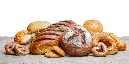 Fresh bread and bakery on sackcloth with white background, with space for text Stock fotó
