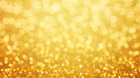 Golden glittering background. Sparkle glitter texture with the bokeh and the lights, shiny metal gold foil