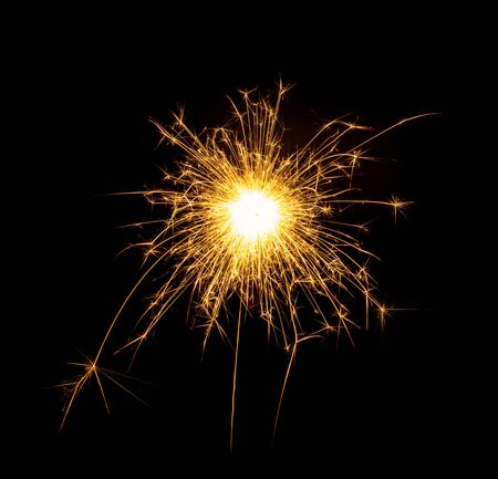 New Year or Christmas bengal fire, sparkler fireworks candle isolated on a black background. Party dark backdrop. 版權商用圖片