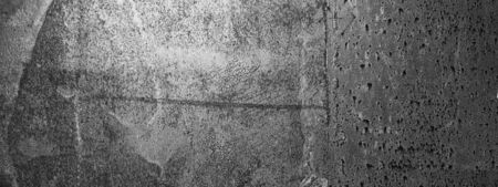 Empty rusty black and white corrosion and oxidized background, panorama, banner. Grunge rusted metal texture. Worn metallic iron wall.