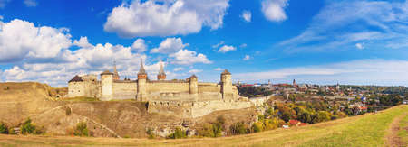 Autumn landscape, panorama, banner - view of a medieval fortified castle on a hill, the town of Kamianets-Podilskyi, Ukraine