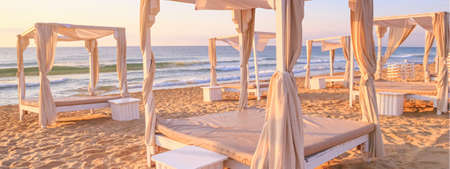 Coastal landscape, banner - view of the sandy seashore with beach gazebos. Beach holiday concept Stock fotó