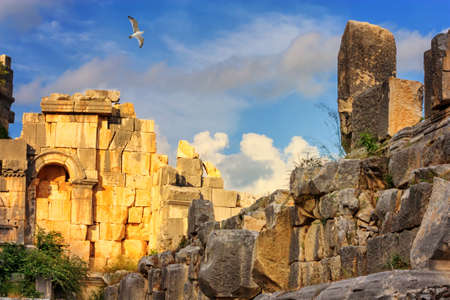 Summer mediterranean cityscape - view of the ruins of the theater in the ancient city of Myra, near the Turkish town of Demre, Antalya Province in Turkey