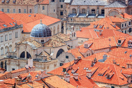 Summer cityscape - top view of the Church of St. Blaise and roofs of buildings in the Old Town of Dubrovnik on the Adriatic Sea coast of Croatia