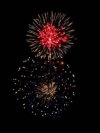 Brightly Colorful Fireworks isolated black background. New Year celebration fireworks.