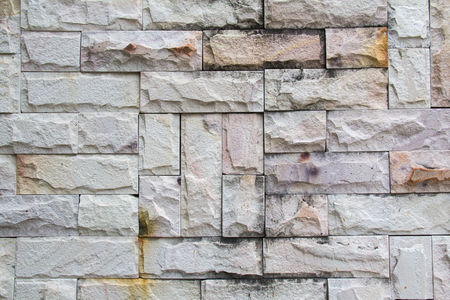 Abstract weathered seamless texture stained old stucco light gray and aged paint white brick wall background in rural room, grungy rusty blocks of stonework technology. High resolution white brick Stock Photo