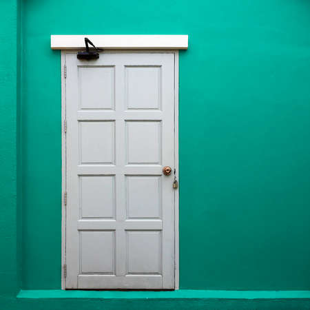 living room wall: Abstract white door with yellow wall background Stock Photo