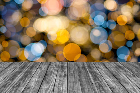 Empty top wooden table and blurred image of christmas lighting bokeh background. for your product display Stock Photo