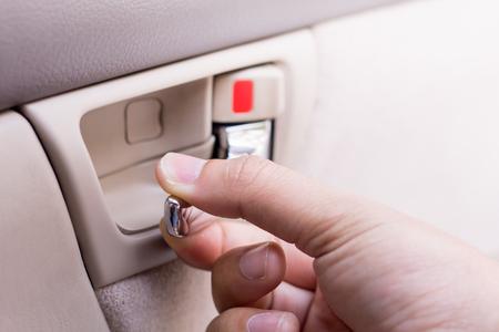 Hand Pulling Car Interior Door Handle Opening Car Door Closeup