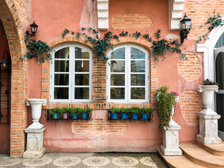 European style window with sand wall background