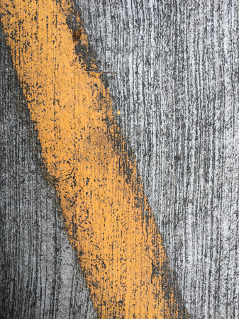 yellow lines on an asphalt road-narrow depth of field