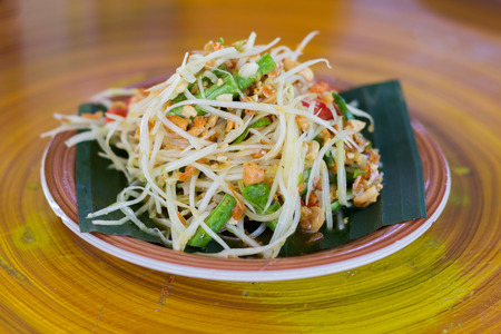 Som tam, Thai delicious raw papaya salad with unique taste hot and spicy, this dish with tomato and crab. Papaya salad with red chili.