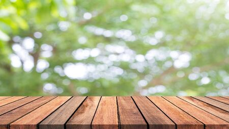 Abstract wooden floor with bokeh nature background.