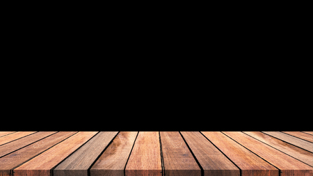 Empty old wooden table with black background.