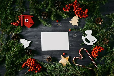Blank business card on a Christmas wooden background. White business card for designers Stock Photo