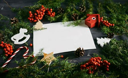 christmas card template: Blank card on a Christmas wooden background. White business card for designers
