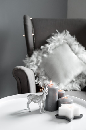 Christmas candles and decor in the home interior. gray interior shades Stock fotó