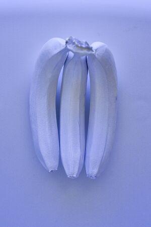 purple bananas on a purple background. Minimal style. gmo concept. GMO.top view Stok Fotoğraf