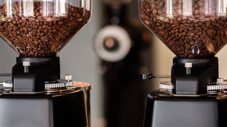 automatic professional coffee maker and coffee grinder in a cafe. Coffee beans Reklamní fotografie