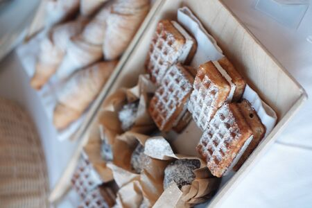 soft stuffed waffles lie on a wooden tray. Viennese waffles. 스톡 콘텐츠