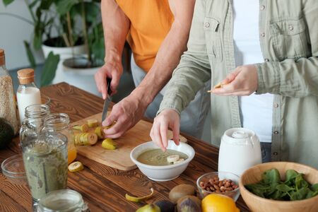 Young married couple is preparing a smoothie. Ingredients for smoothies. The concept of healthy eating and dieting. veggie concept. vegan