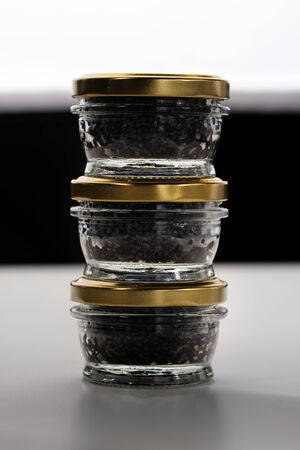 Black sturgeon caviar. Luxurious black caviar. Sturgeon caviar in a glass jar Stockfoto
