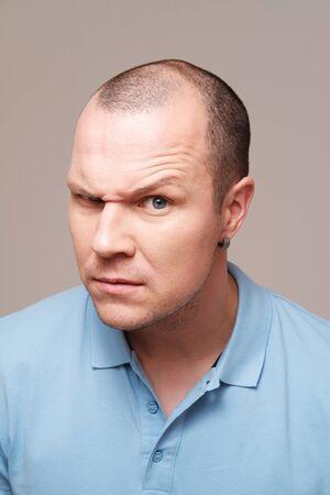 Studio portrait of mid adult man against plain background