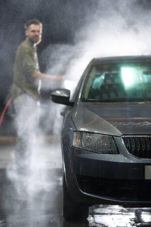 Cleaning Car Using High Pressure Water. Car close-up. Car wash Reklamní fotografie