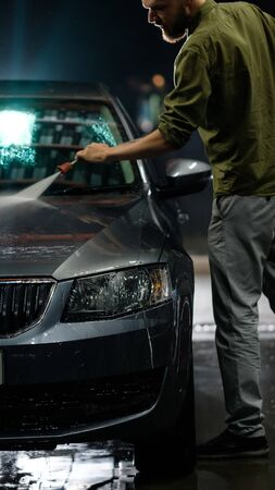 Car close-up. Car wash. Manual car wash with pressurized water in car wash outside.  스톡 콘텐츠