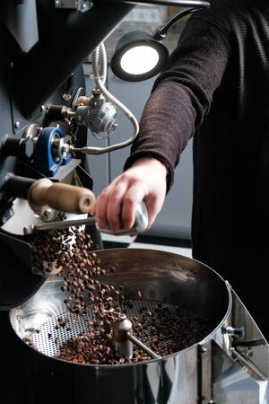 coffee roasting process. coffee roaster. Stock Photo
