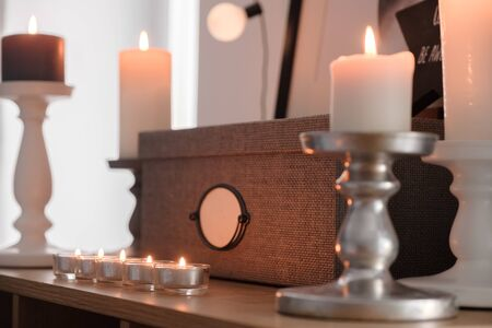 fragments of New Years decor. Candles, fire, homeliness. Scandinavian-style furnishings