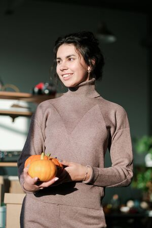 photo of a girl with a pumpkin in her hands. vegetarianism concept. vegan. Healthy vegetables Stock Photo