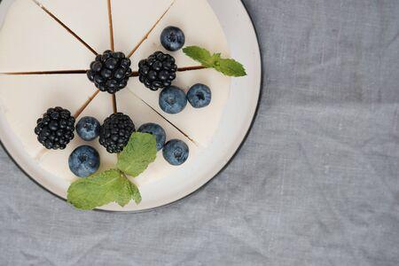 Holiday baking. Cheesecake with berries top view. Minimalism. Scandinavian style Stock fotó