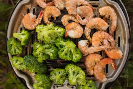 grilled shrimp and vegetables close-up. Picnic. Camping.