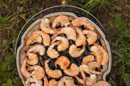 grilled prawns close-up. BBQ Shrimp Process. camping concept