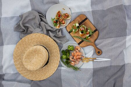 beautiful picnic in nature. sandwiches with tomatoes and herbs, shrimp and grilled vegetables. Healthy food