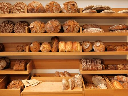 Different kinds of bread on the counter in the bakery shop. Fresh bread counter Stock fotó