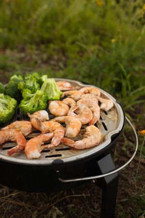 broccoli and prawns on the grill. Outdoor picnic concept. Diet. Stock fotó