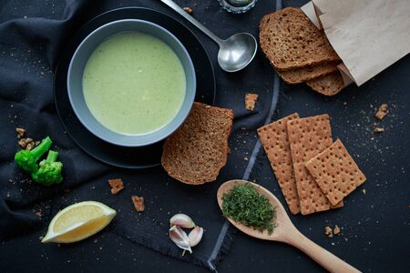Cream soup made of vegetables. Tasty green soup. Creamy soup. Tasty food. dark background