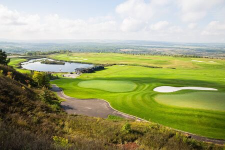 Russian open space. field, forest, sky, road. Summer landscape. golf course top view Stockfoto